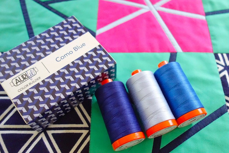 Aurifil Como Blue Color Builder Thread Set on Purity, a baby quilt by Patricia Belyea
