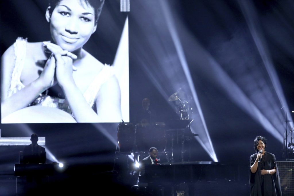 "Gladys Knight performs ""Amazing Grace"" during a tribute to the late singer Aretha Franklin, pictured on screen, at the American Music Awards on Tuesday, Oct. 9, 2018, at the Microsoft Theater in Los Angeles. (Photo by Matt Sayles/Invision/AP)"