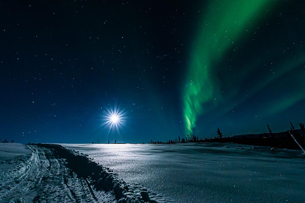 full moon starburst snow winter Aurora Borealis