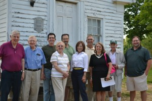 Board members gathered at the Deed house before the August meeting