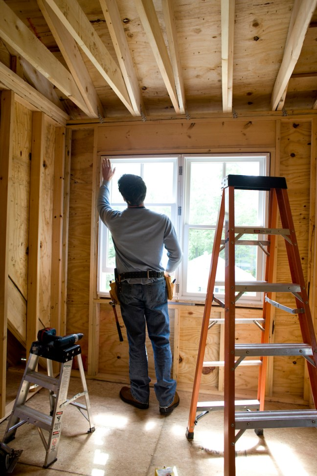 Contractor working on window in new home