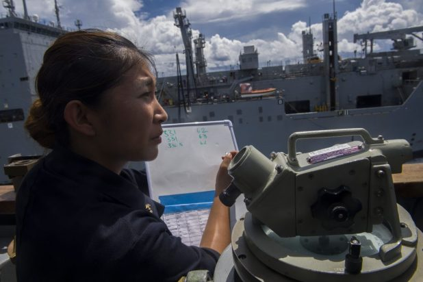CORAL SEA (Aug. 5, 2017) Midshipman 1st Class Elizabeth Giwon Kim, a senior at the U.S. Naval Academy, conducts communications with the Military Sealift Command dry cargo and ammunition ship USNS Charles Drew (T-AKE-10) aboard the Ticonderoga-class guided-missile cruiser USS Shiloh (CG 67) during a replenishment-at-sea. Shiloh was on patrol with Carrier Strike Group 5 in support of security and stability in the Indo-Pacific. (U.S. Navy photo by Mass Communication Specialist 3rd Class Pat Morrissey/Released)