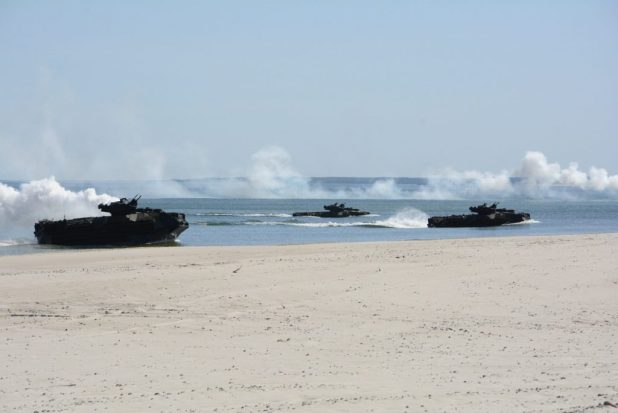 USTKA, Poland (June 7, 2018) AAV-P7/A1 amphibious assault vehicles transport U.S. Marines assigned to the 26th Marine Expeditionary Unit (26th MEU) and embarked aboard the Harpers Ferry-class dock landing ship USS Oak Hill (LSD 51), during beach landing exercise in support of exercise Baltic Operations (BALTOPS) 2018. (U.S. Navy photo by Mass Communication Specialist 1st Class Adam C. Stapleton/Released)