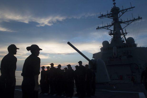 ATLANTIC OCEAN (Sept. 21, 2015) Sailors conduct quarters at sunrise. (U.S. Navy photo by Mass Communication Specialist 2nd Class D.C. Ortega/Released)