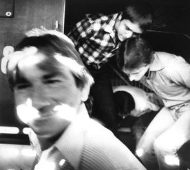 Four of the five men charged with the murder of Anita Cobby, 26, of Blacktown, arrive at the Westmead Coroners Court. Pictured through the grill at the back of the court as men alight from a police van, including Michael Patrick Murphy, front left, Leslie Jospeh Murphy and Gary Stephen Murphy, 13 March 1986.