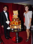 Accused fraudster Joel Morehu-Barlow with his elaborate birthday cake, modelled in the shape of Louis Vuitton trunks.