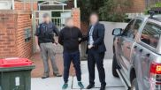 AFP handout photo showing the arrest of Adam Cranston outside his Bondi home. Photo- Australian Federal Police.