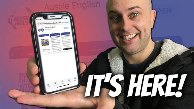 "image shows pete smissen holding a phone showing the aussie english application with the text ""it's here"" below"