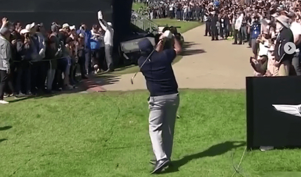 Watch Phil Mickelson play a ridiculous flop-shot over grandstand