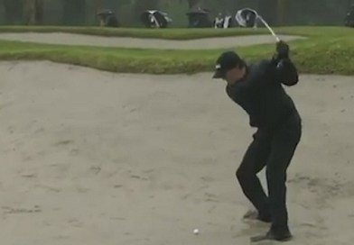 Phil Mickelson makes a wild, wet and sandy par, that won't count