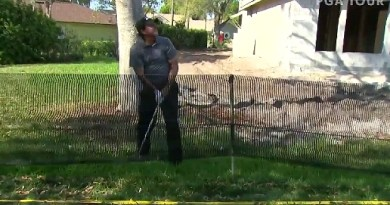 Phil Mickelson tried to hit a shot under a fence and it didn't end well
