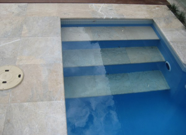 Swimming pool floors and stairs designed with Oberon marble flooring tiles