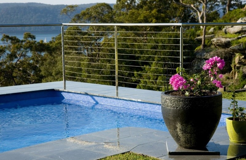Swimming pool design using Aussietecture bindoon limestone paver and some vases as decoration