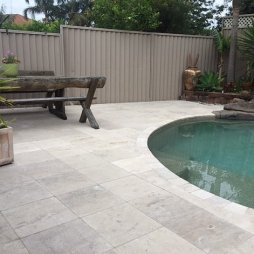 limestone tiles and pavers seen in swimming pool flooring and edging design