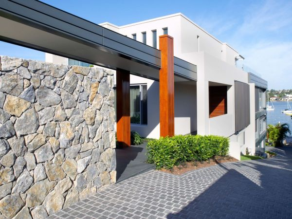 Exterior wall design using eyre irregular wall cladding stone and outdoor floor design with cobblestone