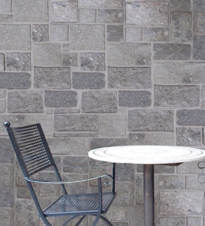 Aussietecture Beltana colonial walling stones used as wall claddings in a residential house exterior wall near a swimming pool