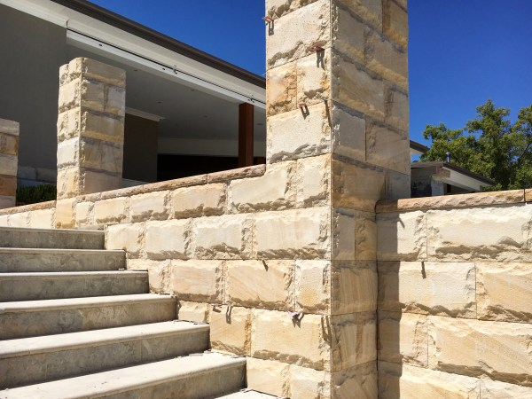 Burraneer Bay project using Rock face sandstone walling, sandstone capping and stone stairs.