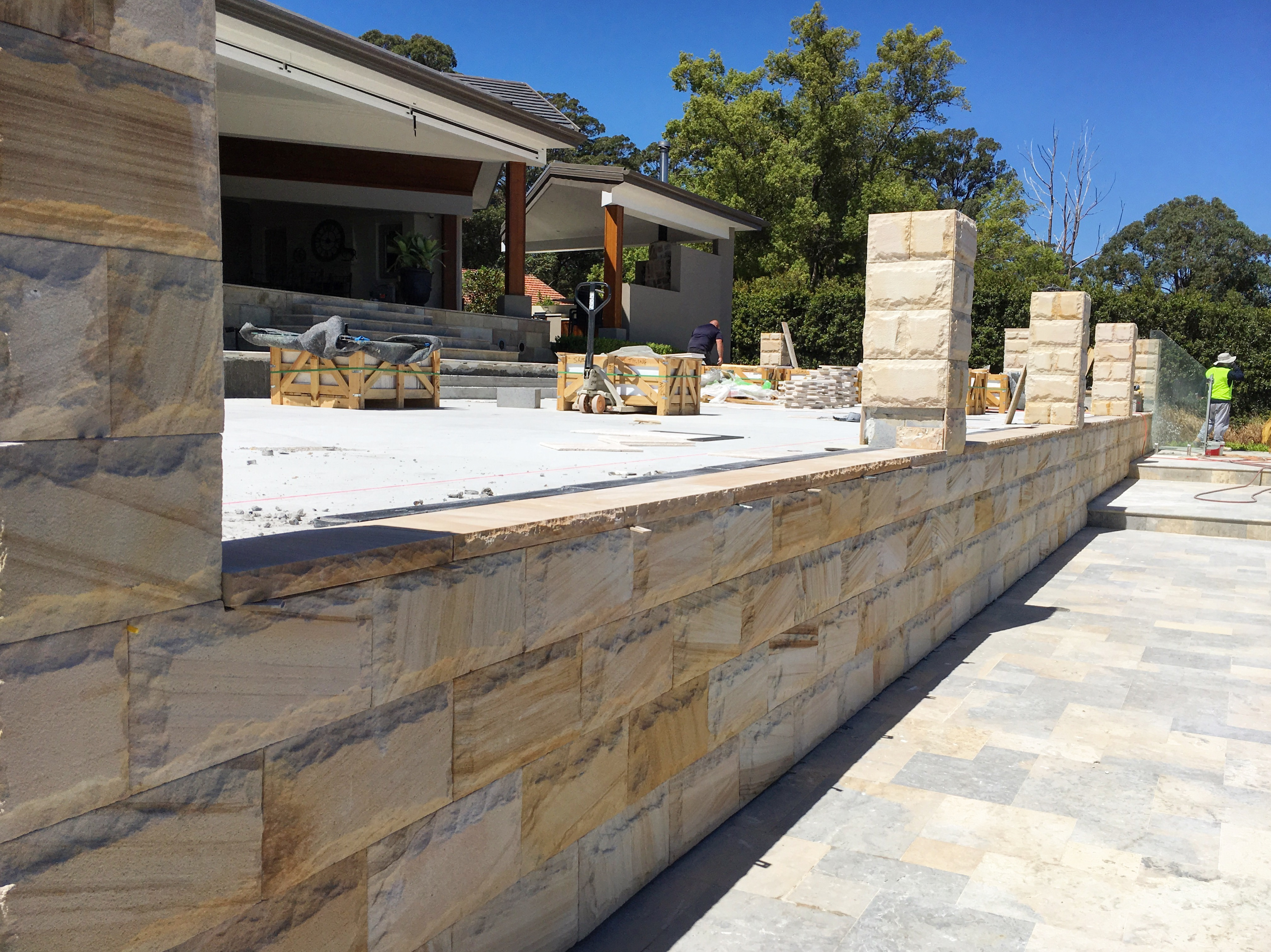 Outdoor stone wall using rockface sandstone and capping stones