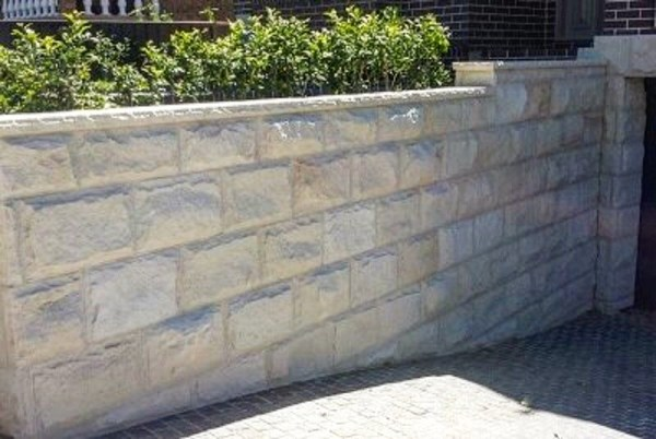 Rockface sandstone cladding used in contemporary house exterior wall