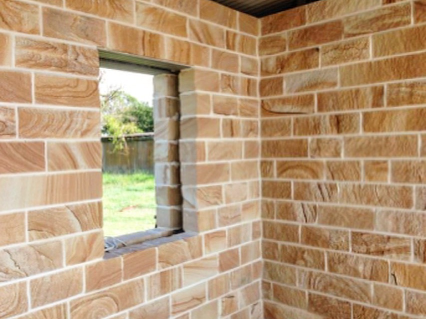 Stone house build with Australian local sourced sandstone, rock face finish