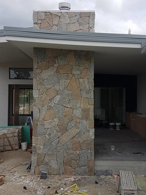 A residential wall renovation project, Tilpa natural stone walling seen as exterior cladding stone
