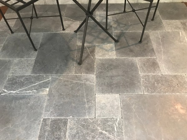 Bindoon limestone pavers in an interior residential flooring application with some furniture
