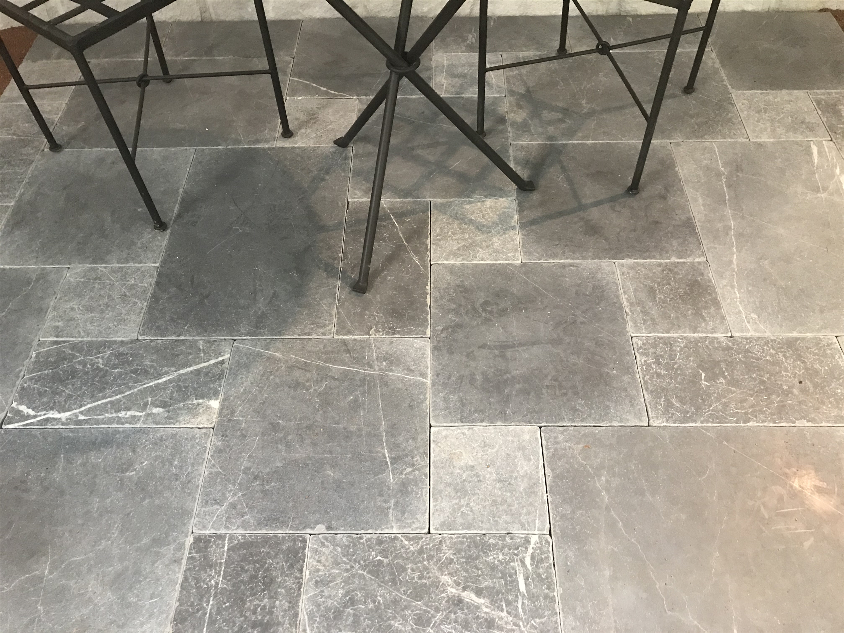 Tumbled limestone paving stone Bindoon laid in French pattern in a interior house floor design
