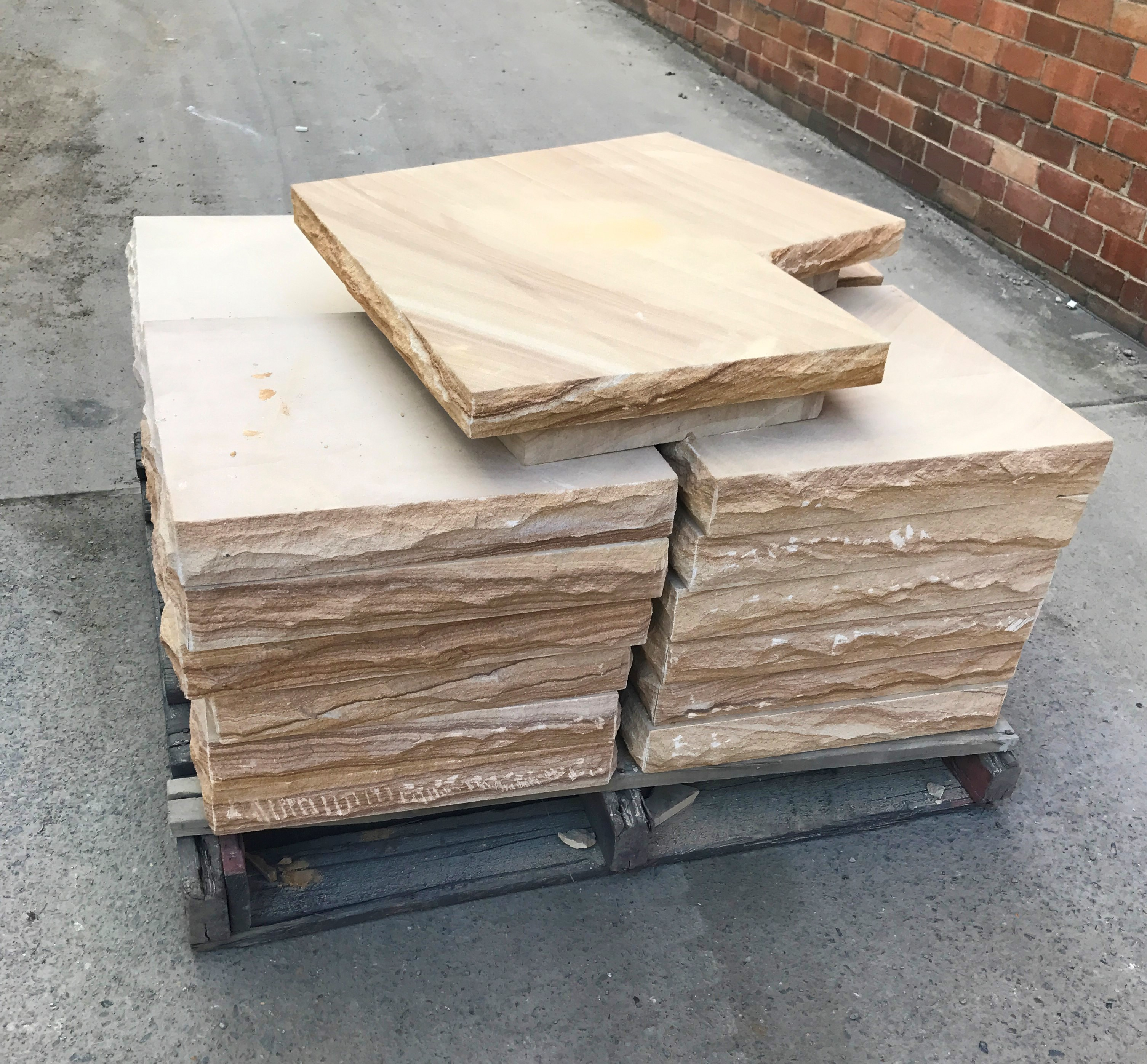 Stone caps in a pallet ready to be packed and shipped around Australian for commercial building projects
