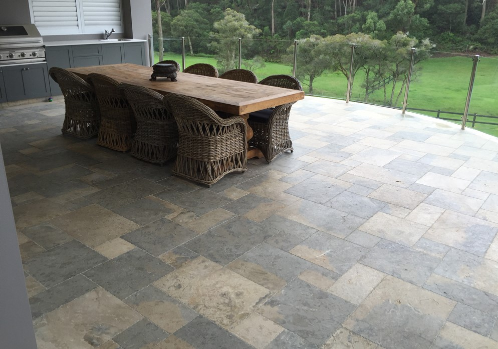 Residential floor design featuring marble pavers laid in a modular patter