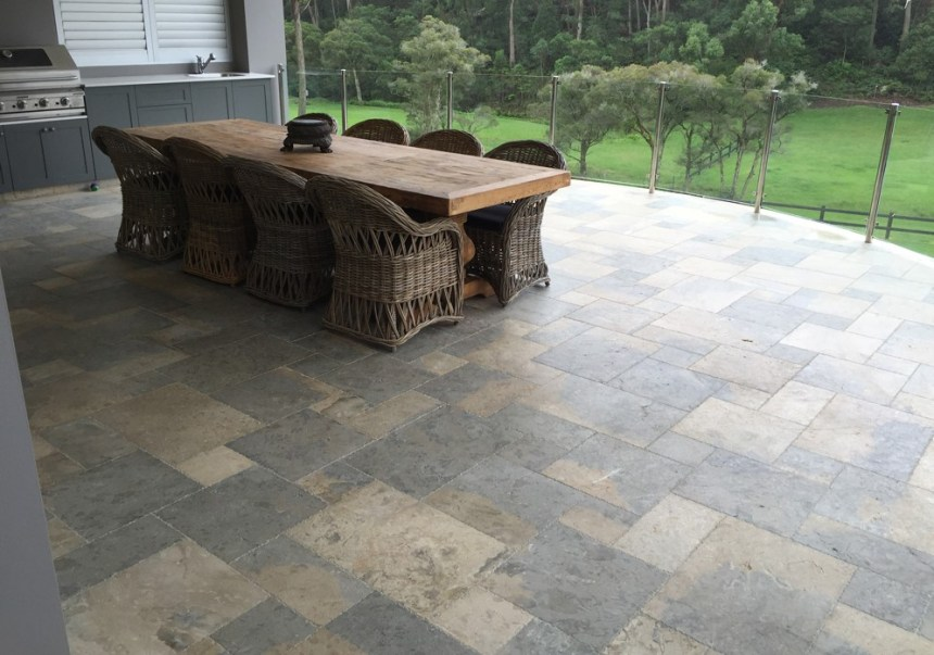 Residential floor design featuring limestone pavers laid in a modular patters