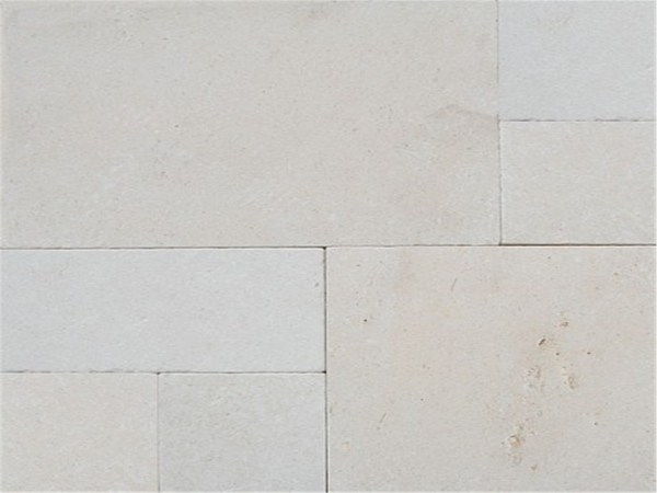 Derby tumbled limestone pavers laid in French pattern for house flooring