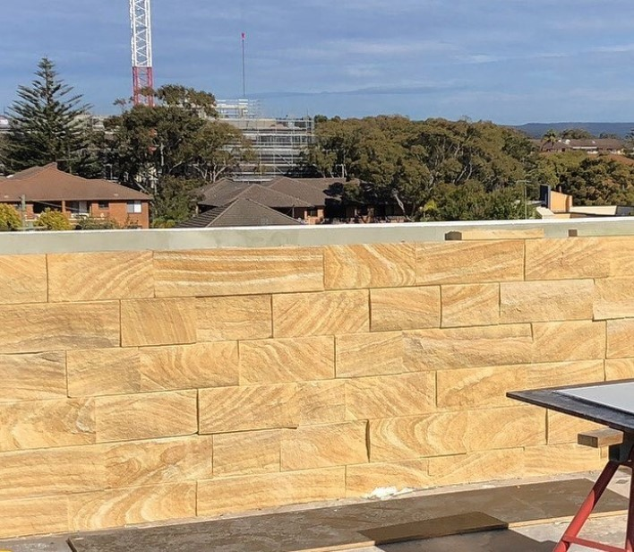 Exterior building project using Aussietecture kirra banded wall cladding stone