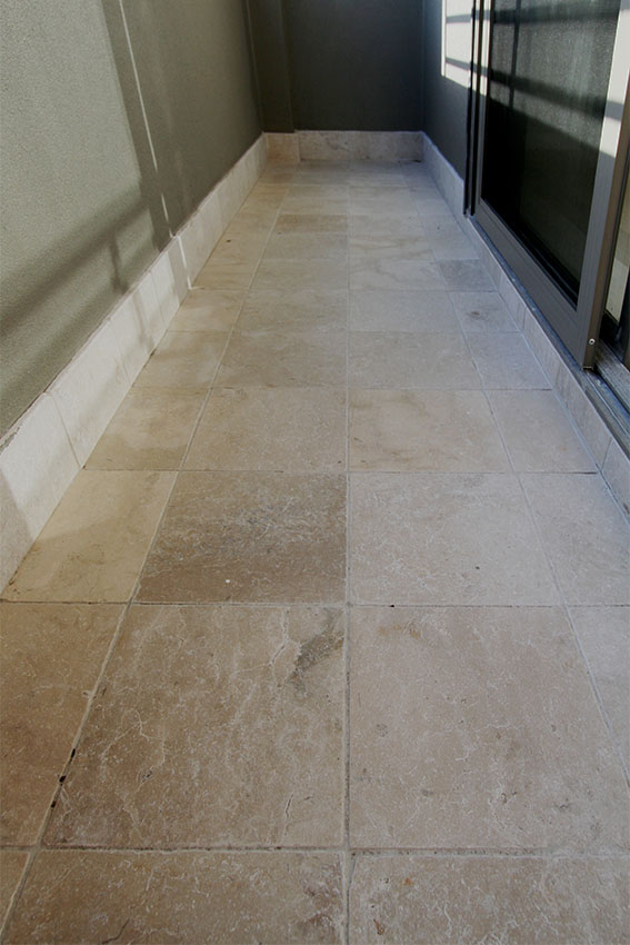 Interior floor designed with Cattai marble tumbled stone in tiling