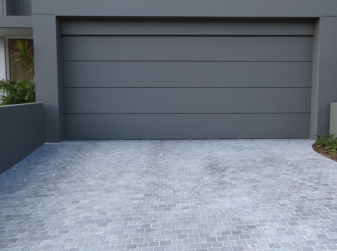 Bindoon cobble paving stone seen in a residential garage drive way