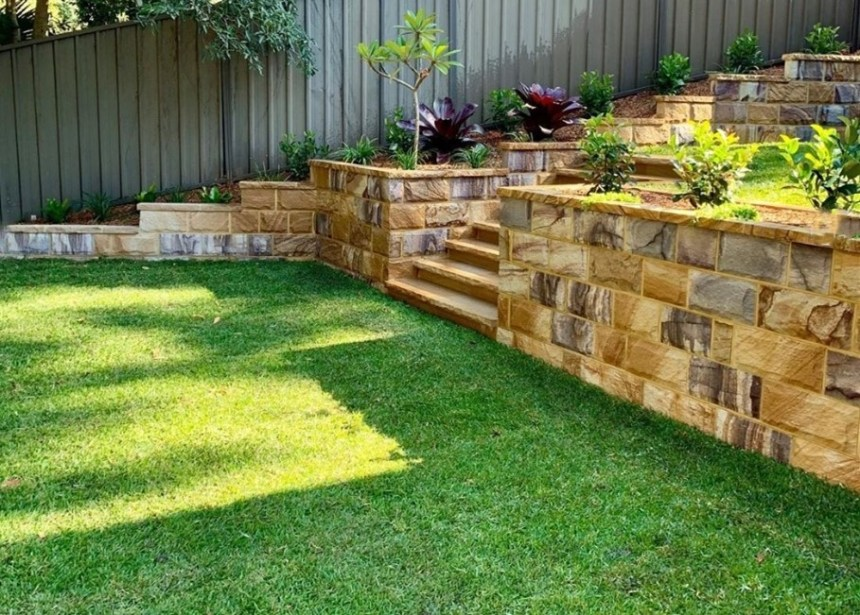 Landscape project of a residential yard using ranch Australian sandstone walling and capping stone