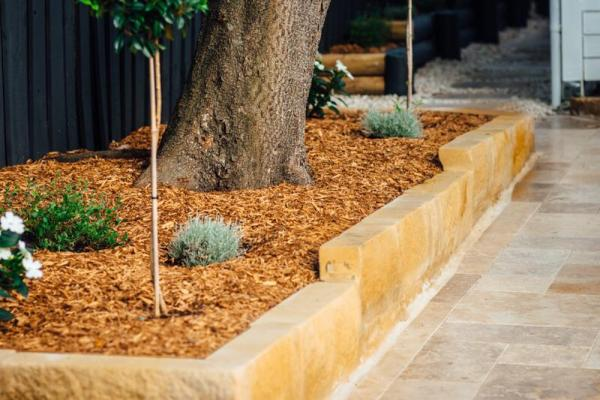Landscaping picture of Garden edging using sandstone blocks and a big tree