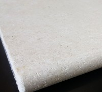 Limestone pool coping stone with tumbled edge