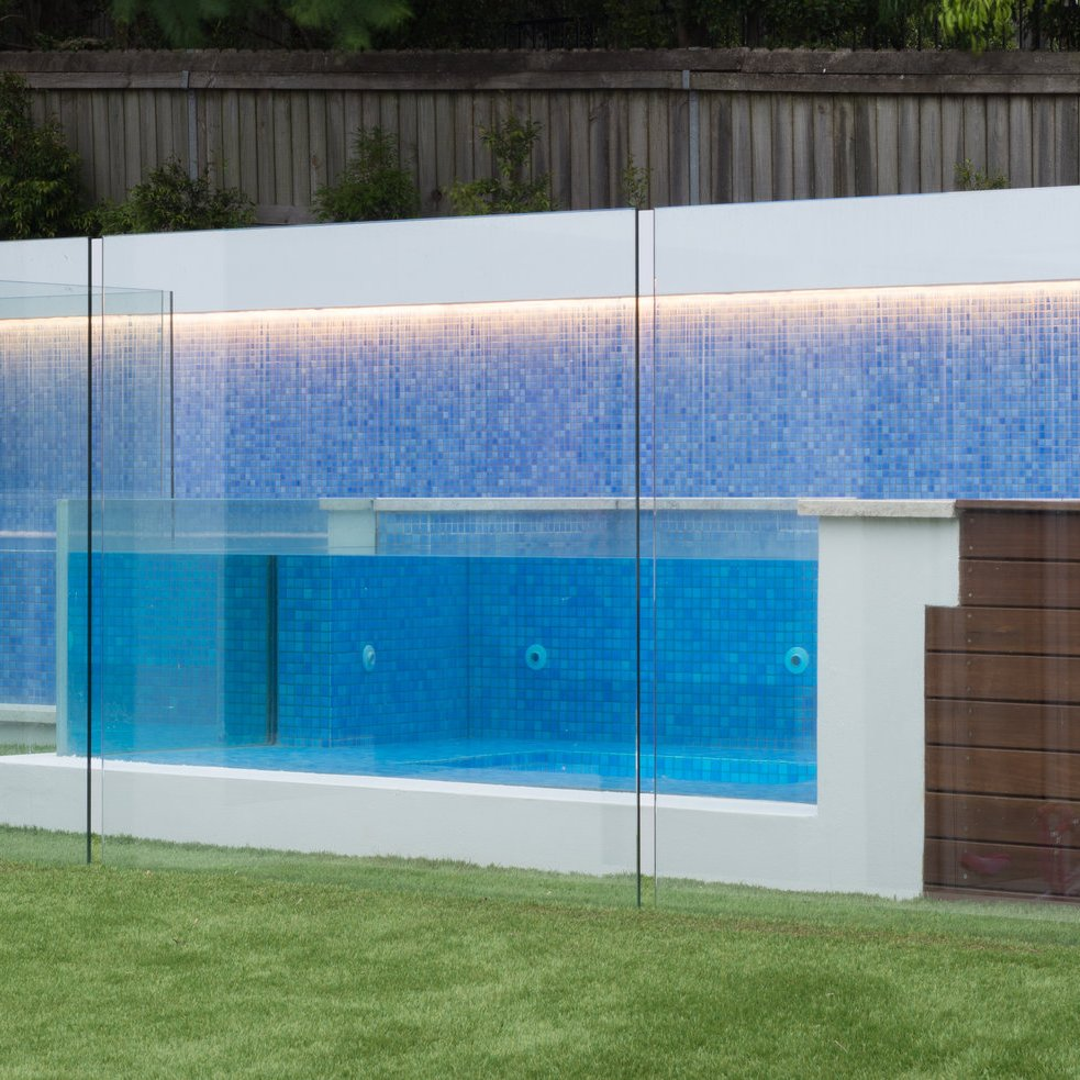 Swimming pool tiling with Bora glass mosaic pool tile and timber flooring