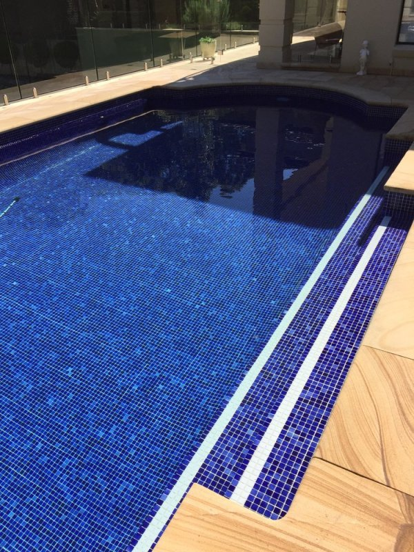 sandstone Pool coping stones and glass mosaic in residential swimming pool project