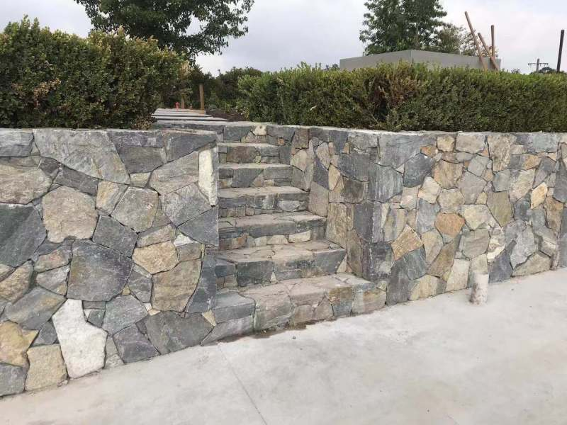 Eyre irregular walling stone in a outdoor landscaping, using as dry cladding in walls and stairs