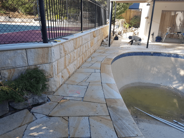 Banded Sandstone Crazy paving and rockface sandstone seen in a swimming pool projectject