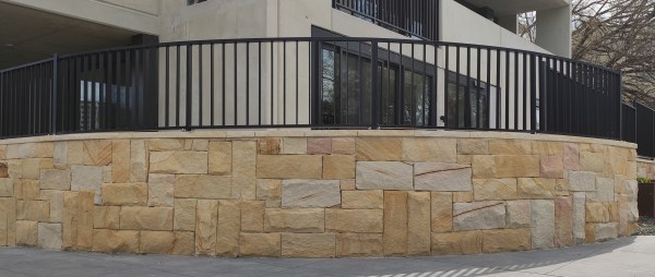 Colonial banded cladding sandstone in residential building