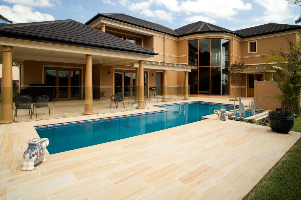 Imported-Sandstone-Honed-paver in a residential swimming pool floor project