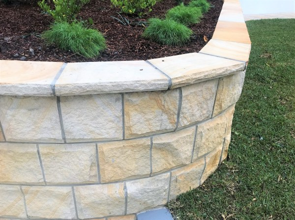 Rockface sandstone wall cladding seen in a landscaping project