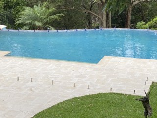 Swimming pool project with Derby limestone paver and capping