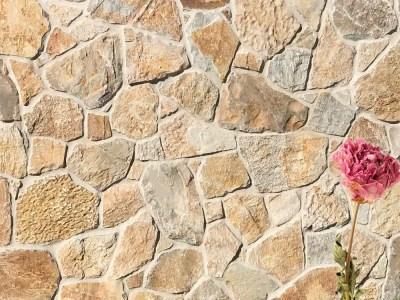 Laverton irregular limestone cladding with a flower decoration
