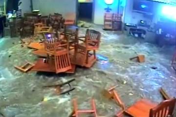 Flood waters devastate Shoal Creek Saloon.