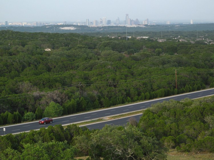 Photo: Southwest Parkway with the Austin skyline in the background. Flickr user Matthew Rutledge, creative commons licensed.