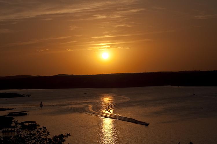 lake-travis-sunset-boat-jet-ski-wake-dusk