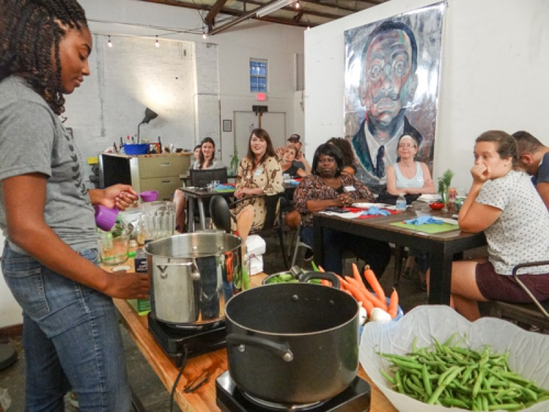 A captive Learnshop audience watches as Sheena demonstrates the proper pickling technique